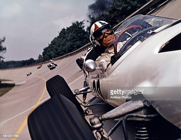 James Garner races in a scene from the film 'Grand Prix' 1966