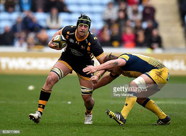 James Gaskell of Wasps is tackled by Jack Singleton of Worcester Rugby during the AngloWelsh Cup match between Wasps and Worcester Rugbyat The Ricoh...