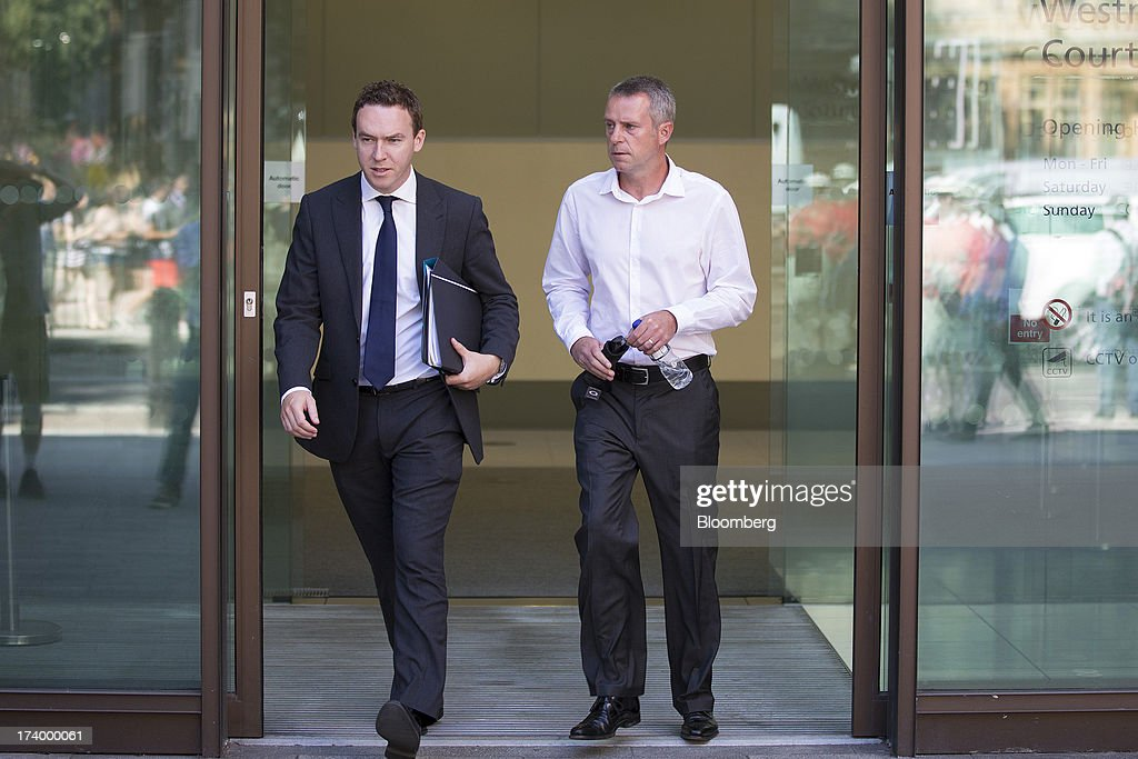 James Gilmour, a former broker at RP Martin Holdings Ltd., right, leaves after appearing at Westminster Magistrates Court in London, U.K., on Friday, July 19, 2013. Two former RP Martin Holdings Ltd. employees, Gilmour and Terry Farr, who became the first brokers to face prosecution in the global probe of manipulation of the London interbank offered rate made their first appearance in a London courtroom. Photographer: Simon Dawson/Bloomberg via Getty Images