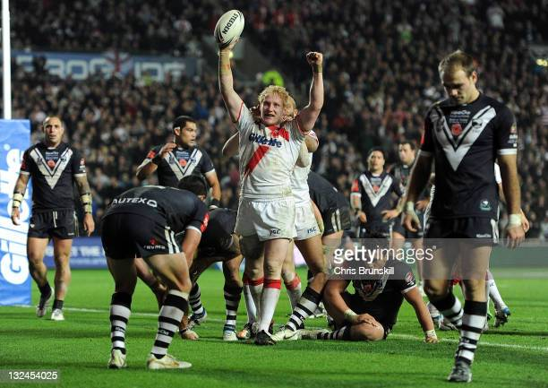 James Graham of England celebrates after going over for a try during the Four Nations match between England and New Zealand at KC Stadium on November...