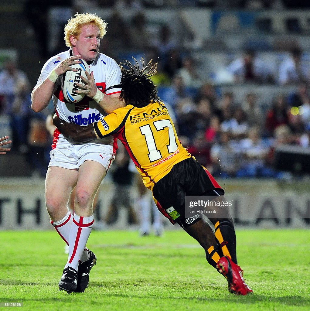 James Graham of England is tackled by Charlie Wabo of Papua New Guinea during the 2008 Rugby League World Cup Pool 1 match between England and Papua...