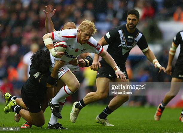 James Graham of England isheld up by Tohu Harris of New Zealand during the third International Rugby League Test Series match between England and New...