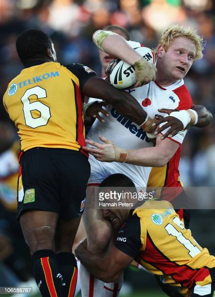James Graham of England looks to offload during the Four Nations match between England and Papua New Guinea at Eden Park on November 6 2010 in...