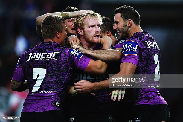 James Graham of the Bulldogs celebrates after scoring a try during the round 10 NRL match between the CanterburyBankstown Bulldogs and the New...