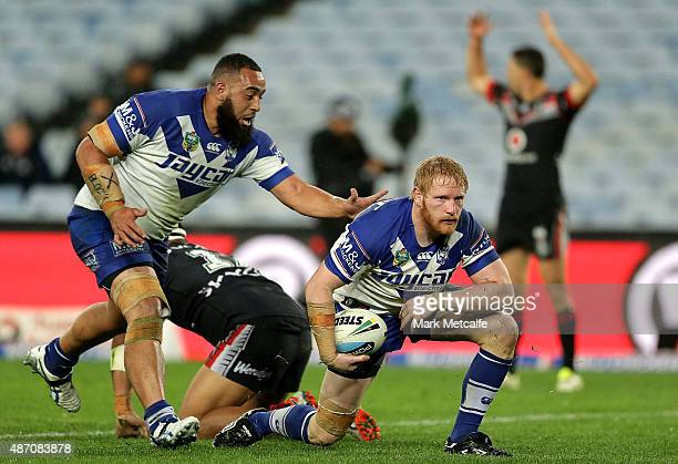 James Graham of the Bulldogs celebrates scoring the winning try with team mates during the round 26 NRL match between the Canterbury Bulldogs and the...
