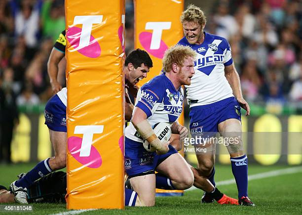 James Graham of the Bulldogs celebrates with team mates after scoring a try during the NRL Second Preliminary Final match between the Penrith...
