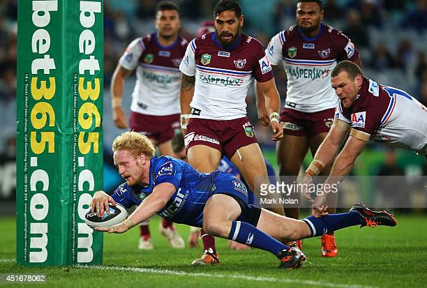 James Graham of the Bulldogs dives over to score a try during the round 17 NRL match between the Canterbury Bulldogs and the Manly Sea Eagles at ANZ...