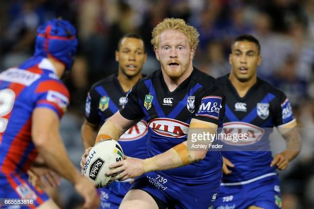 James Graham of the Bulldogs is tackled by the Knights defence during the round six NRL match between the Newcastle Knights and the Canterbury...