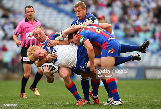 James Graham of the Bulldogs is tackled during the NRL Elimination Final match between the Canterbury Bulldogs and the Newcastle Knights at ANZ...