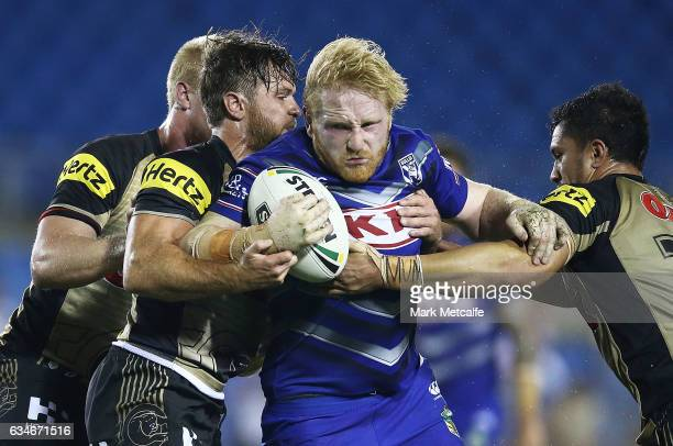 James Graham of the Bulldogs is tackled during the NRL Trial match between the Canterbury Bulldogs and the Penrith Panthers at Belmore Sports Ground...
