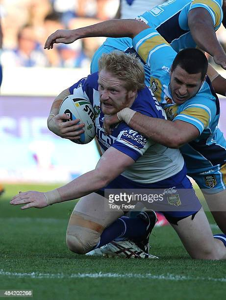 James Graham of the Bulldogs is tackled during the round 23 NRL match between the Canterbury Bulldogs and the Gold Coast Titans at Central Coast...