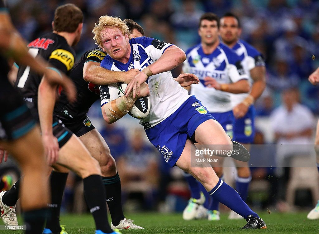 James Graham of the Bulldogs is tackled during the round 25 NRL match between the Canterbury Bulldogs and the Penrith Panthers at ANZ Stadium on August 31, 2013 in Sydney, Australia.