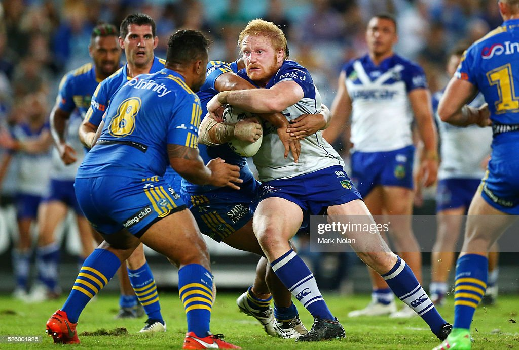 <a gi-track='captionPersonalityLinkClicked' href=/galleries/search?phrase=James+Graham+-+Rugby+Player&family=editorial&specificpeople=15021163 ng-click='$event.stopPropagation()'>James Graham</a> of the Bulldogs is tackled during the round nine NRL match between the Parramatta Eels and the Canterbury Bulldogs at ANZ Stadium on April 29, 2016 in Sydney, Australia.