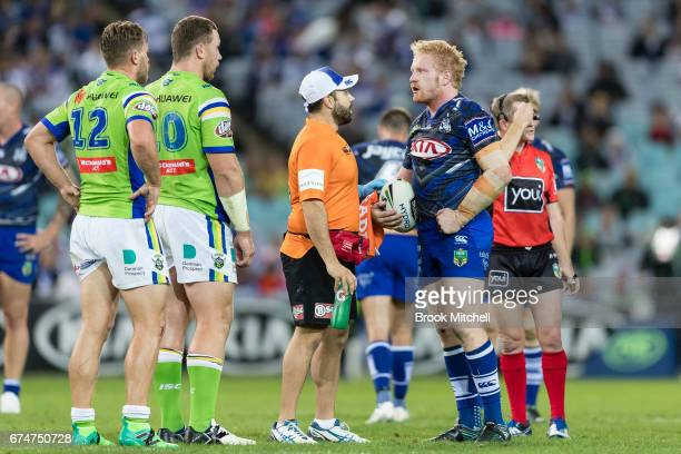 James Graham of the Bulldogs is taken off under the concussion rule during the round nine NRL match between the Canterbury Bulldogs and the Canberra...