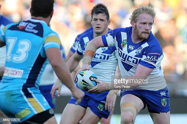 James Graham of the Bulldogs looks to pass the ball during the round 23 NRL match between the Canterbury Bulldogs and the Gold Coast Titans at...