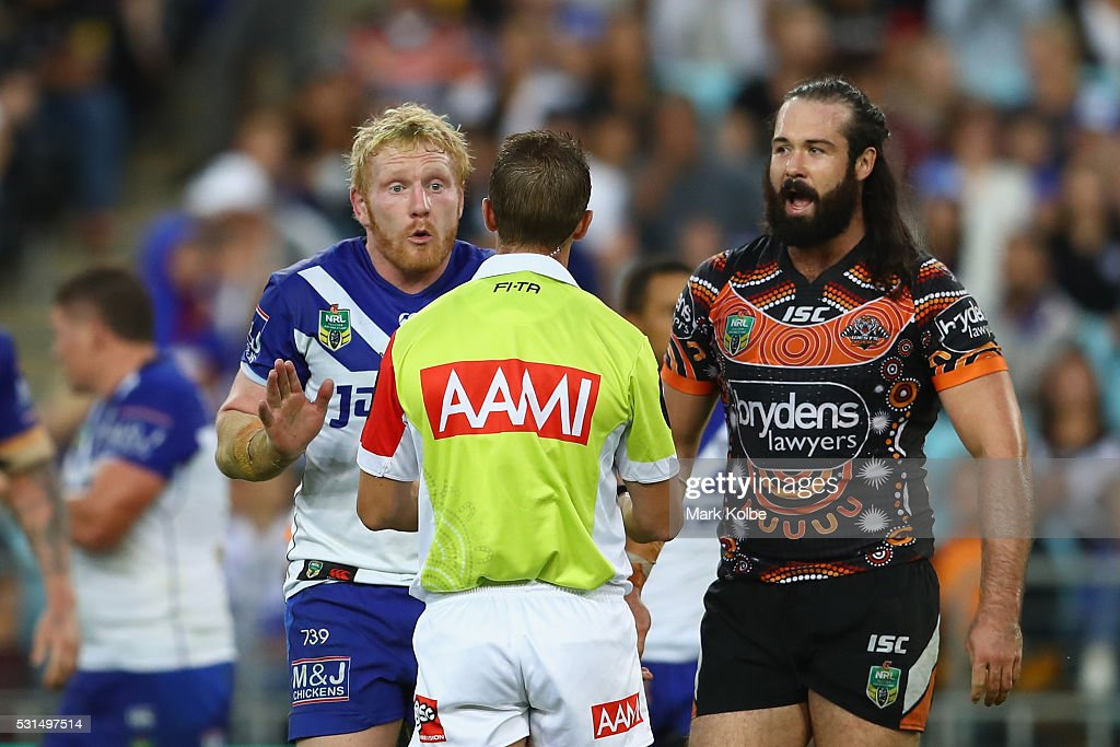 James Graham of the Bulldogs makes his point to the referee as Aaron Woods of the Tigers watches on during the round 10 NRL match between the Wests Tigers and the Canterbury Bulldogs at ANZ Stadium on May 15, 2016 in Sydney, Australia.