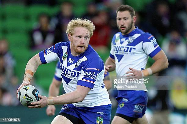 James Graham of the Bulldogs prepares to offload the ball during the round 18 NRL match between the Melbourne Storm and the Canterbury Bulldogs at...