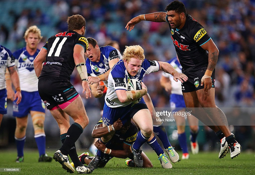James Graham of the Bulldogs runs the ball during the round 25 NRL match between the Canterbury Bulldogs and the Penrith Panthers at ANZ Stadium on August 31, 2013 in Sydney, Australia.