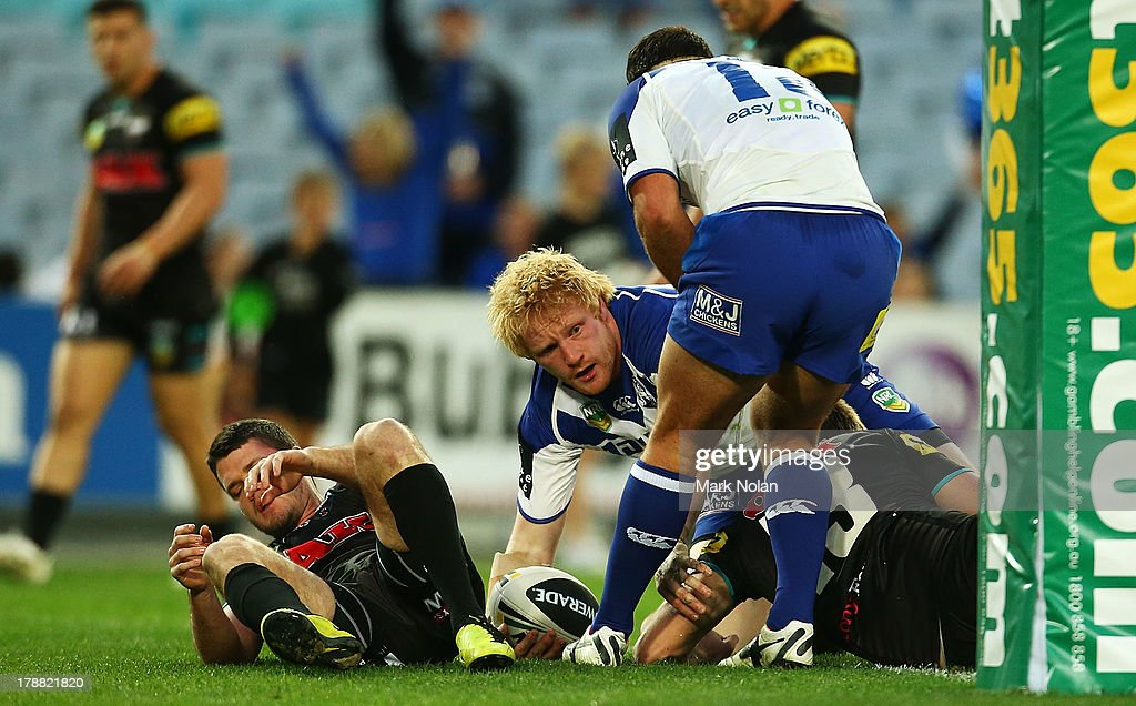 James Graham of the Bulldogs scores during the round 25 NRL match between the Canterbury Bulldogs and the Penrith Panthers at ANZ Stadium on August 31, 2013 in Sydney, Australia.