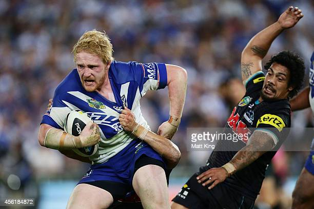 James Graham of the Bulldogs takes on the defence during the NRL Second Preliminary Final match between the Penrith Panthers and the Canterbury...