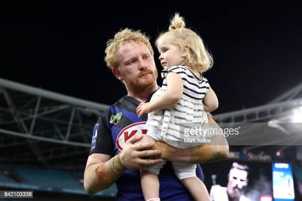 James Graham of the Bulldogs walks with his daughter after the round 26 NRL match between the St George Illawarra Dragons and the Canterbury Bulldogs...