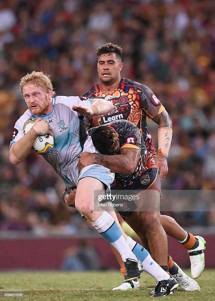 James Graham of the World All Stars is tackled during the NRL match between the Indigenous All-Stars and the World All-Stars at Suncorp Stadium on February 13, 2016 in Brisbane, Australia.