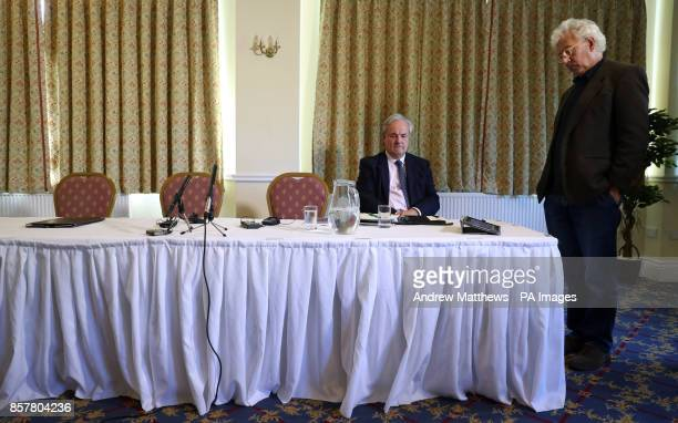 James Gray MP for North Wiltshire and Lincoln Seligman godson of Sir Edward Heath watch a statement by Wiltshire Police on an iPad prior to a press...
