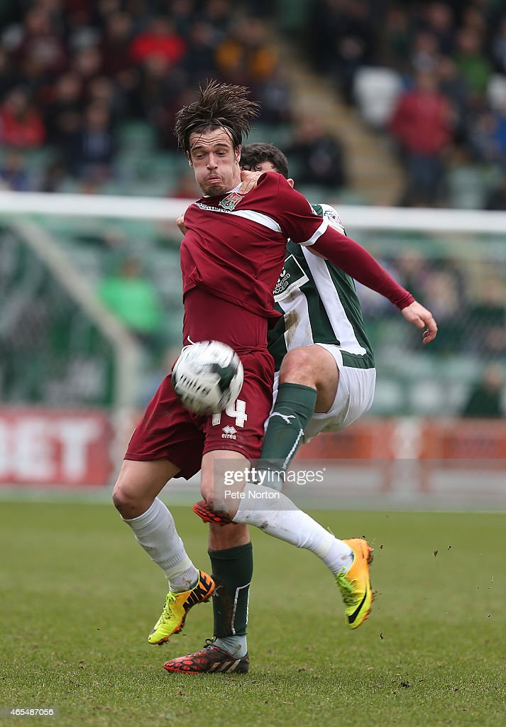 James Gray of Northampton Town attempts to control the ball under pressure from Carl McHugh of Plymouth Argylevduring the Sky Bet League Two match between Plymouth Argyle and Northampton Town at Home Park on March 7, 2015 in Plymouth, England.