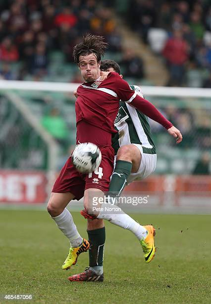 James Gray of Northampton Town attempts to control the ball under pressure from Carl McHugh of Plymouth Argylevduring the Sky Bet League Two match...