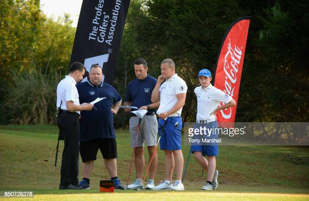 James Green of Portsmouth Golf Course and Tim Higgs of Portsmouth Golf Course pose on the 1st tee with Callum Gaughan of Normanton Golf Club and...