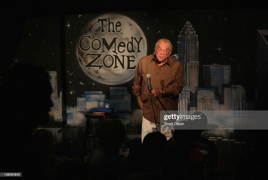 James Gregory entertains guests at the Comedy Zone located in the NC Music Factory on July 12, 2012 in Charlotte, North Carolina. The NC Music Factory, located on the grounds of a former textile factory, houses several bars restaurants and entertainment venues. Businesses in Charlotte are anticipating a boost in sales when an estimated 35,000 visitors arrive in the city for the 2012 Democratic National Convention (DNC) September 3-6.