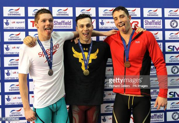 James Guy poses with his gold medal after winning The Men's 200 Metre Freestyle alongside second placed Duncan Scott and third placed Calum Jarvis...