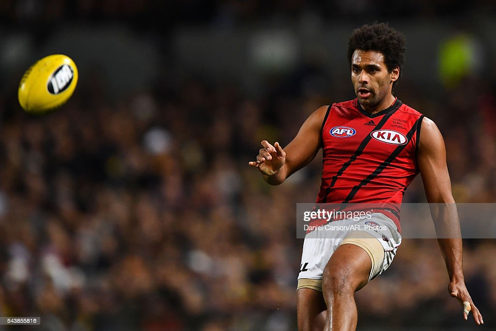 James Gwilt of the Bombers kicks during the 2016 AFL Round 14 match between the West Coast Eagles and the Essendon Bombers at Domain Stadium on June 30, 2016 in Perth, Australia.