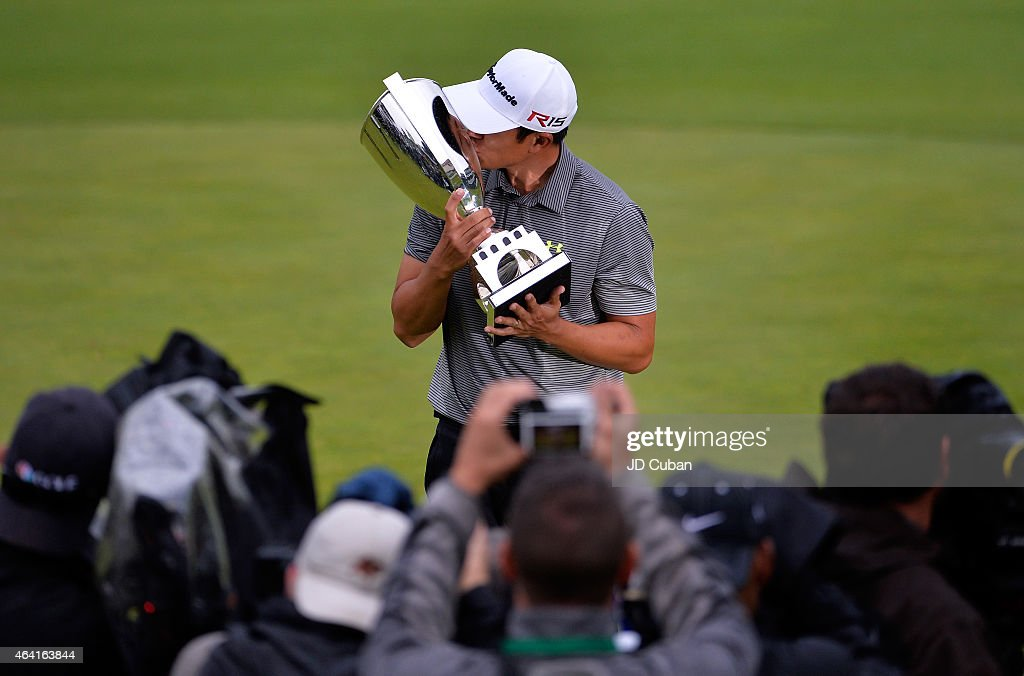 James Hahn holds the trophy on the 18th hole after putting in for the win on the 14th hole during the third round playoff during the Final Round of the Northern Trust Open at the Riviera Country Club on February 22, 2015 in Pacific Palisades, California.