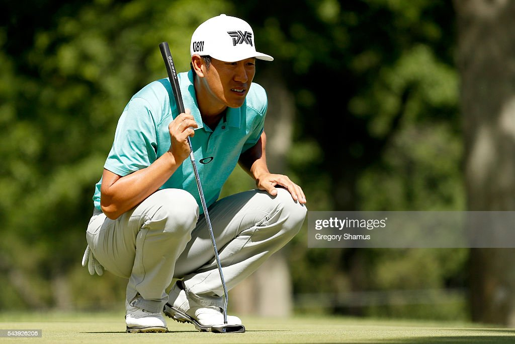 <a gi-track='captionPersonalityLinkClicked' href=/galleries/search?phrase=James+Hahn+-+Golfer&family=editorial&specificpeople=15809875 ng-click='$event.stopPropagation()'>James Hahn</a> lines up a putt on the second green during the first round of the World Golf Championships - Bridgestone Invitational at Firestone Country Club South Course on June 30, 2016 in Akron, Ohio.