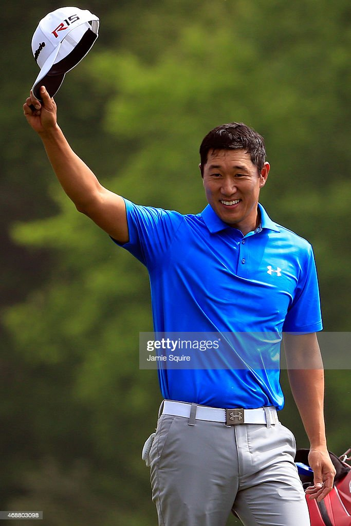 James Hahn of Soiuth Korea reacts to a hole-in-one on the 12th hole during a practice round prior to the start of the 2015 Masters Tournament at Augusta National Golf Club on April 7, 2015 in Augusta, Georgia.