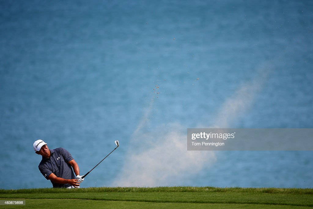 James Hahn of the United States plays a bunker shot on the 16th hole during the first round of the 2015 PGA Championship at Whistling Straits on August 13, 2015 in Sheboygan, Wisconsin.