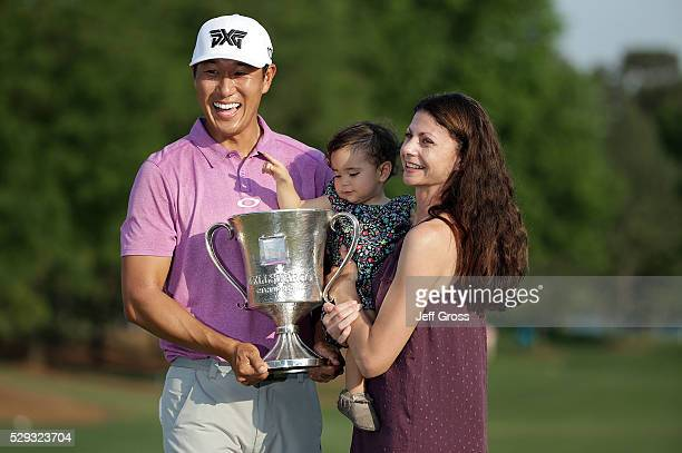 James Hahn poses with his wife Stephanie and daughter Kailee following the final round of the Wells Fargo Championship at Quail Hollow Club on May 8...