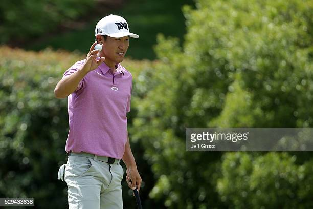 James Hahn waves to the crowd on the seventh hole during the final round of the Wells Fargo Championship at Quail Hollow Club on May 8 2016 in...