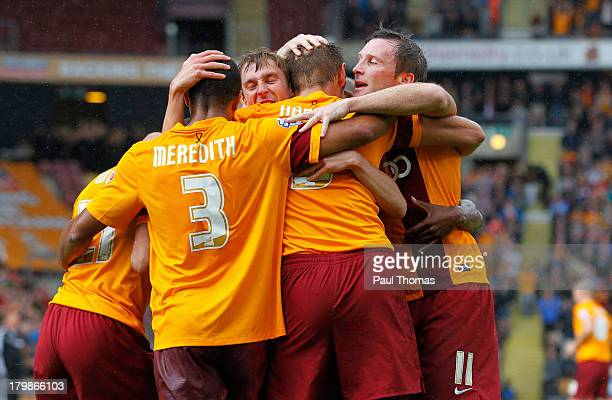 James Hanson of Bradford celebrates his goal with team mates during the Sky Bet League One match between Bradford City and Brentford at the Coral...