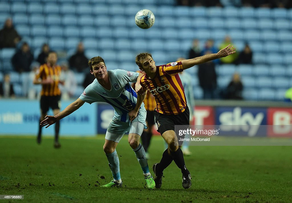 James Hanson of Bradford City battles with Chris Stokes of Coventry City during the Sky Bet League One match between Coventry City and Bradford City at Ricoh Arena on March 10, 2015 in Coventry, England.