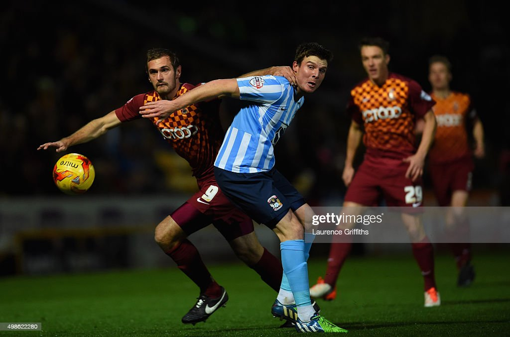 James Hanson of Bradford City battles with Chris Stokes of Coventry City during the Sky Bet League One match between Bradford City and Coventry City...