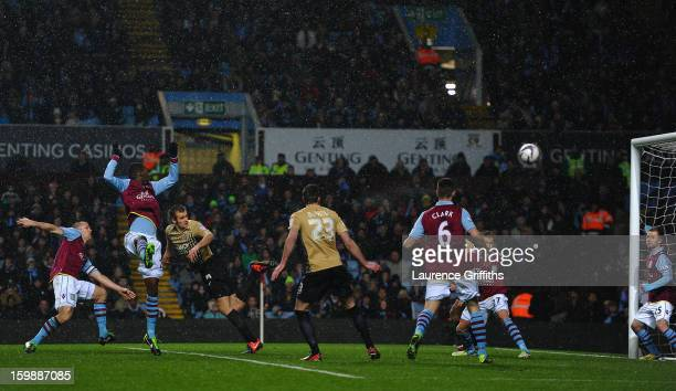 James Hanson of Bradford City scores his team's first goal during the Capital One Cup SemiFinal Second Leg between Aston Villa and Bradford City at...
