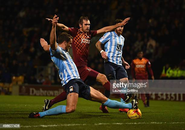 James Hanson of Bradford City shoots at goal under pressure from Ben Turner of Coventry City during the Sky Bet League One match between Bradford...