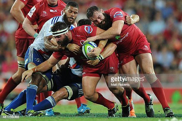 James Hanson of the Reds is tackled during the round seven Super Rugby match between the Reds and the Stormers at Suncorp Stadium on March 29 2014 in...