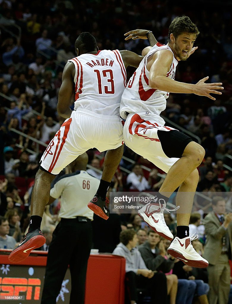 <a gi-track='captionPersonalityLinkClicked' href=/galleries/search?phrase=James+Harden&family=editorial&specificpeople=4215938 ng-click='$event.stopPropagation()'>James Harden</a> #13 and <a gi-track='captionPersonalityLinkClicked' href=/galleries/search?phrase=Chandler+Parsons&family=editorial&specificpeople=4249869 ng-click='$event.stopPropagation()'>Chandler Parsons</a> #25 of the Houston Rockets celebrate after a play against the Boston Celtics at the Toyota Center on December 14, 2012 in Houston, Texas.