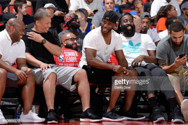 James Harden and Chris Paul of the Houston Rockets talk with Head Coach Tyronn Lue of the Cleveland Cavaliers during the game during the 2017 Las...