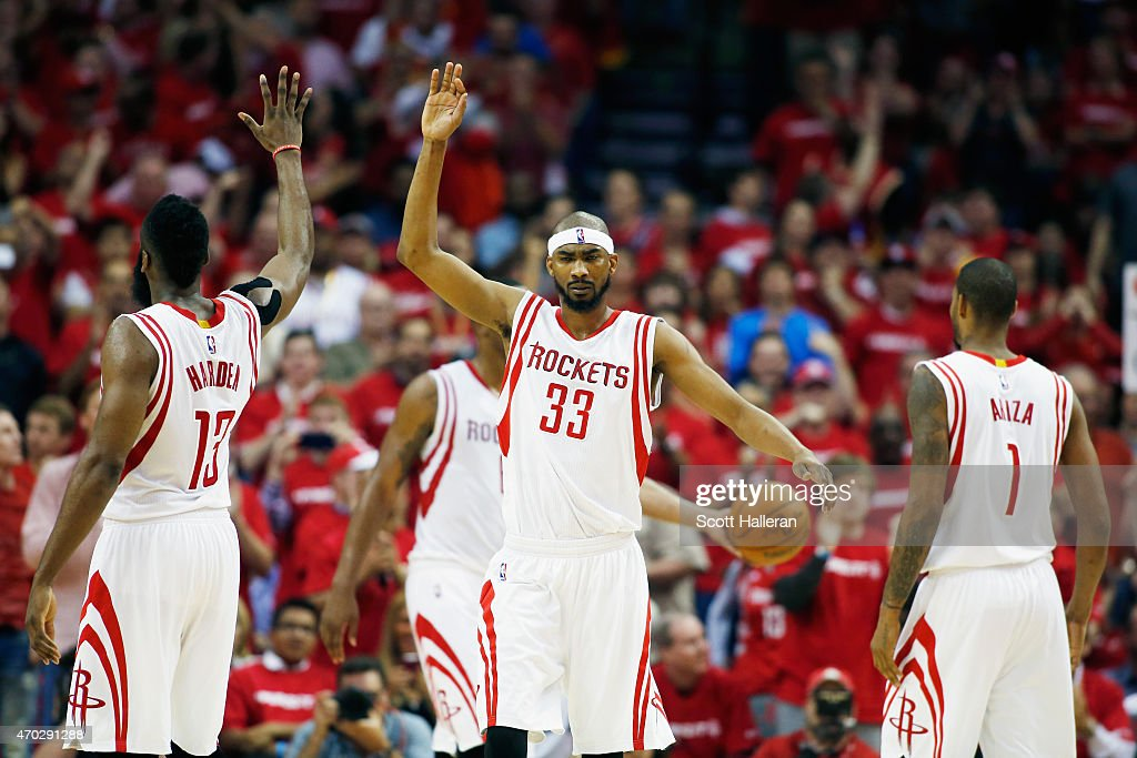 James Harden #13 and Corey Brewer #33 of the Houston Rockets celebrate after a play against the Dallas Mavericks during Game One in the Western Conference Quarterfinals of the 2015 NBA Playoffs on April 18, 2015 at the Toyota Center in Houston, Texas.