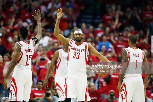 James Harden and Corey Brewer of the Houston Rockets celebrate after a play against the Dallas Mavericks during Game One in the Western Conference...