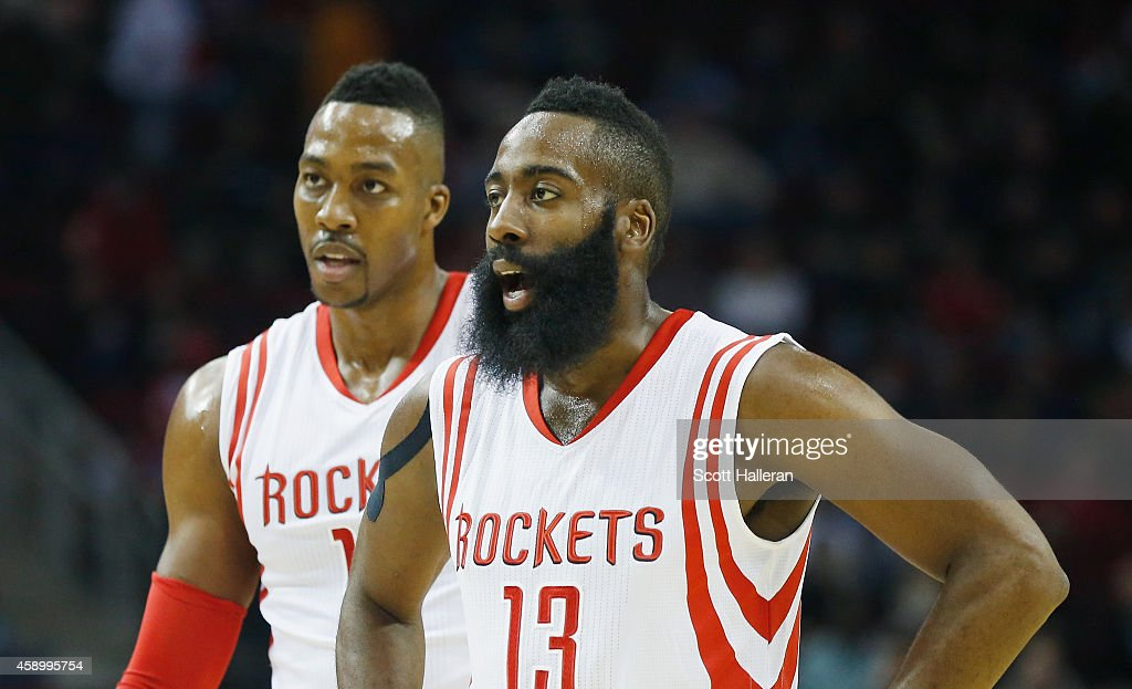 <a gi-track='captionPersonalityLinkClicked' href=/galleries/search?phrase=James+Harden&family=editorial&specificpeople=4215938 ng-click='$event.stopPropagation()'>James Harden</a> #13 and <a gi-track='captionPersonalityLinkClicked' href=/galleries/search?phrase=Dwight+Howard&family=editorial&specificpeople=201570 ng-click='$event.stopPropagation()'>Dwight Howard</a> #12 of the Houston Rockets wait on the court during the game against the Philadelphia 76ers at the Toyota Center on November 14, 2014 in Houston, Texas.